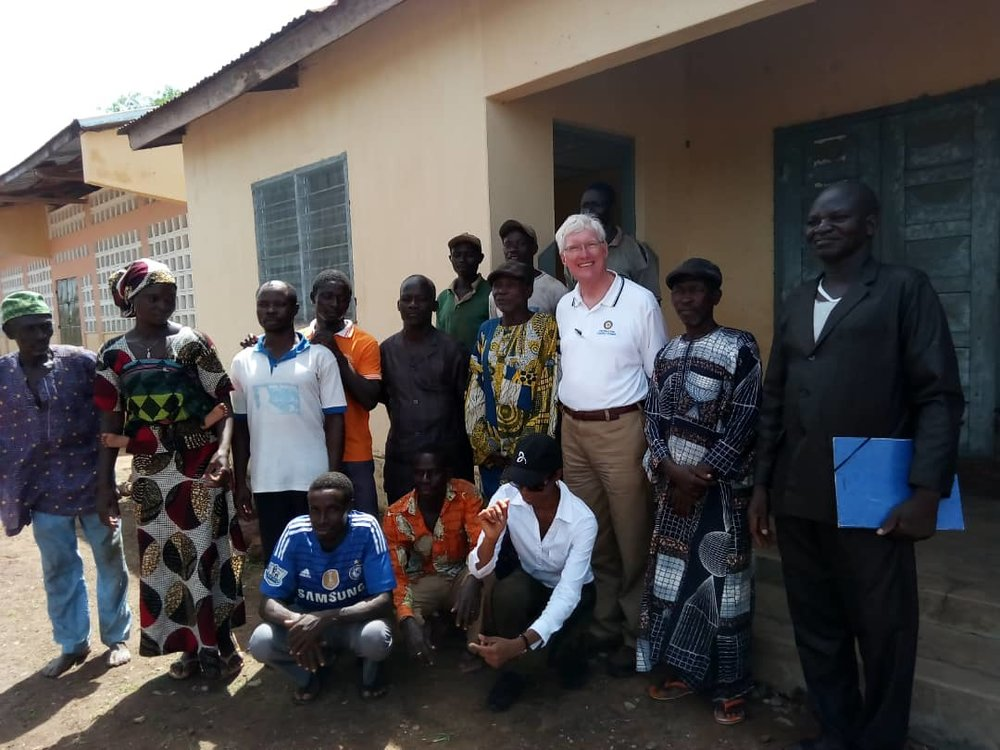Meeting with school principal and members of the village council in Atchoua, Togo.  Sherwood was conducting a site visit in preparation for a Rotary International project to drill wells and build latrines in order to provide clean water and sanitary facilities for the village.