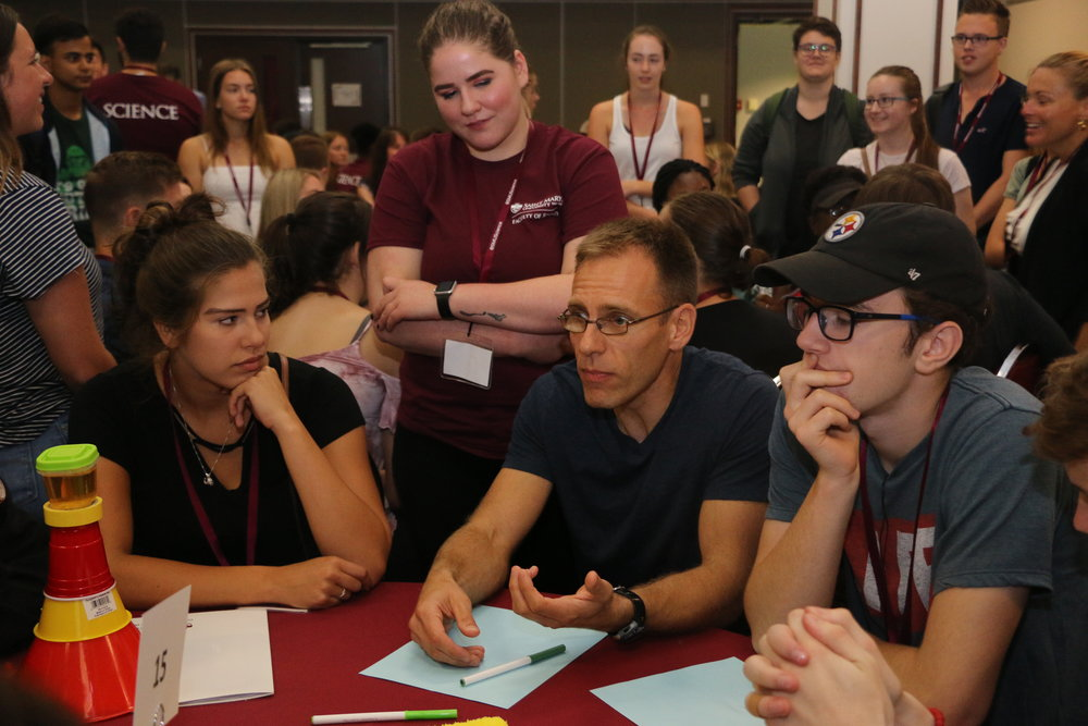 Students listen intently to Mathematics professor Dr. John Irving.