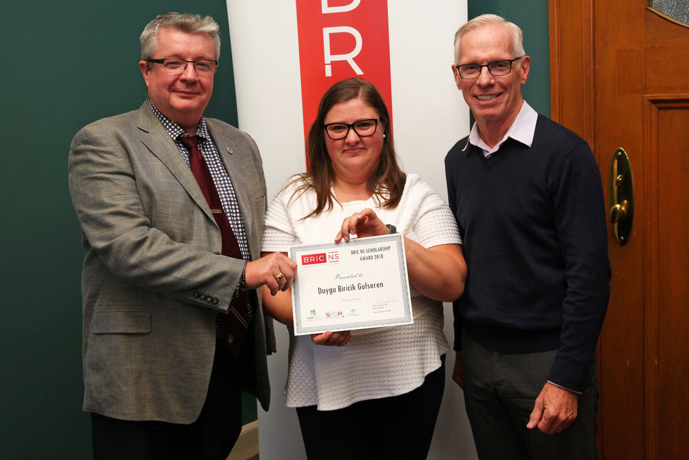 Photo: PhD in Industrial and Organizational Psychology candidate Duygu Biricik Gulseren (centre) with Dr. Fred Burge, BRIC NS & Dalhousie University (right); and Duygu's supervisor, Dr. Kevin Kelloway, Saint Mary's University