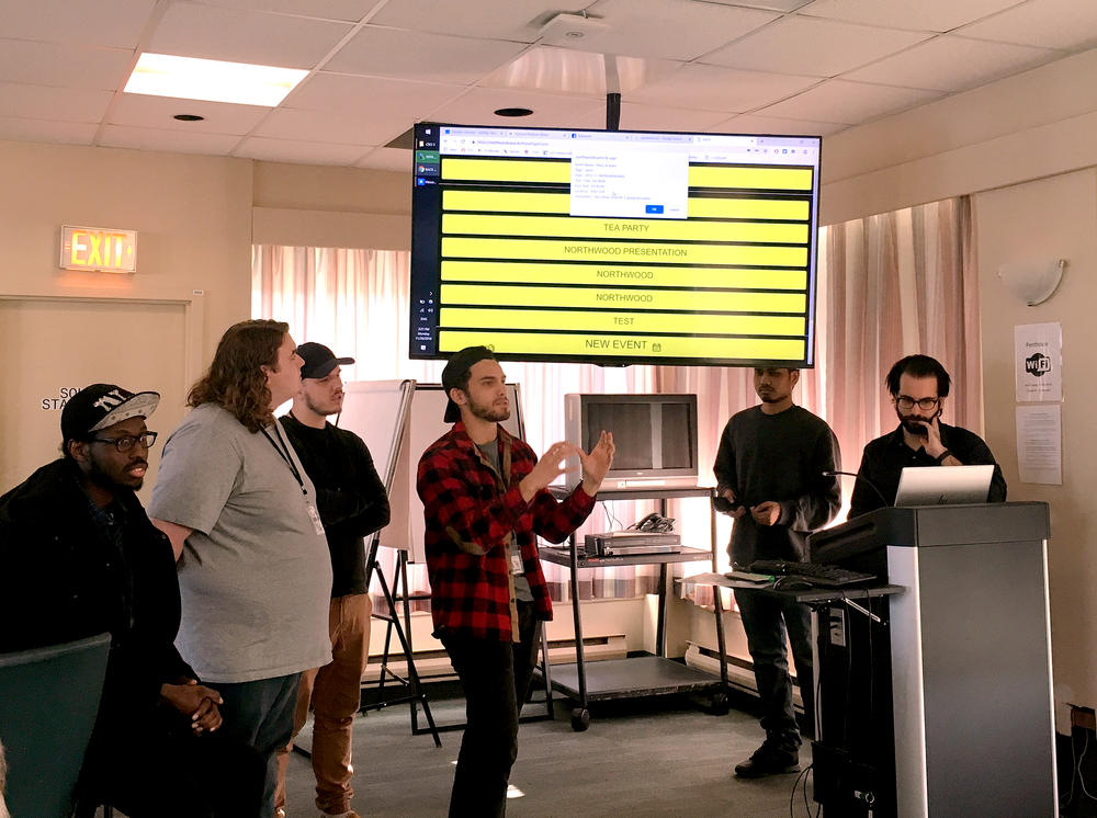 Students present their projects to residents during their final visit to Northwood's Halifax Campus.