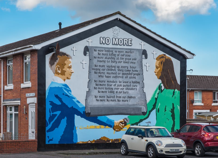 A Belfast peace mural showing a Loyalist boy with a Catholic girl .