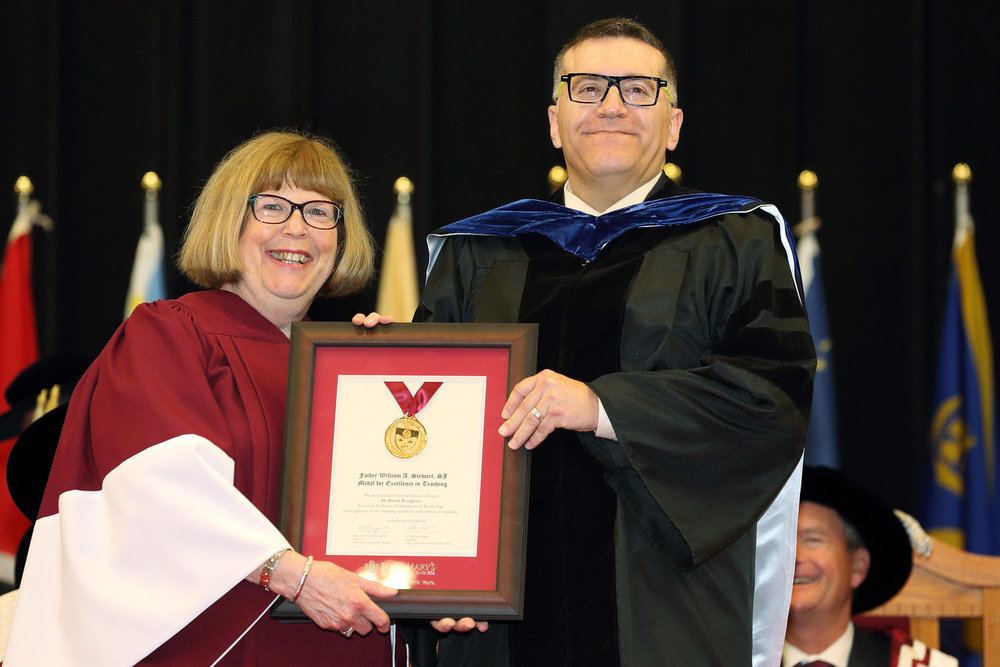 Mary-Evelyn Ternan (BA'69, BEd'70, MEd'88), Past President of the Saint Mary's Alumni Association presents Dr. David Bourgeois with the Father William A. Stewart Medal for Excellence in Teaching in 2018.
