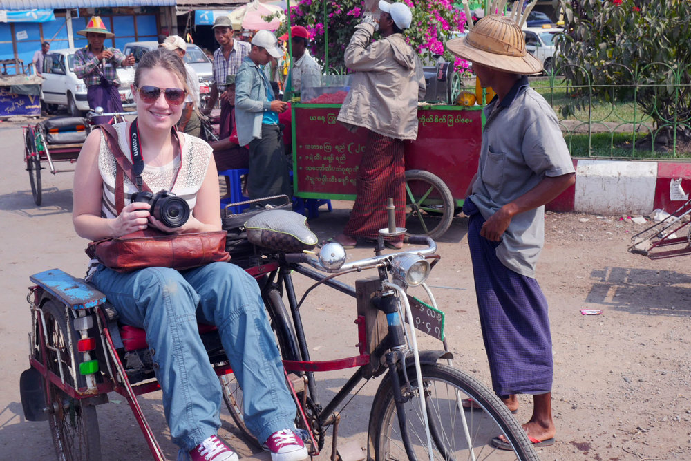 Riding a bicycle taxi on a filming trip to Myanmar (Burma).