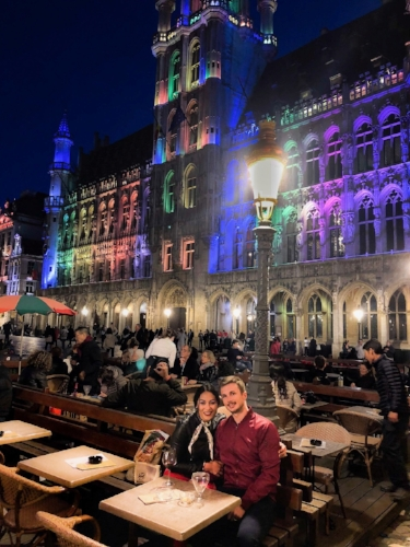 brussels grand place at night buildings multi-color rainbow evening