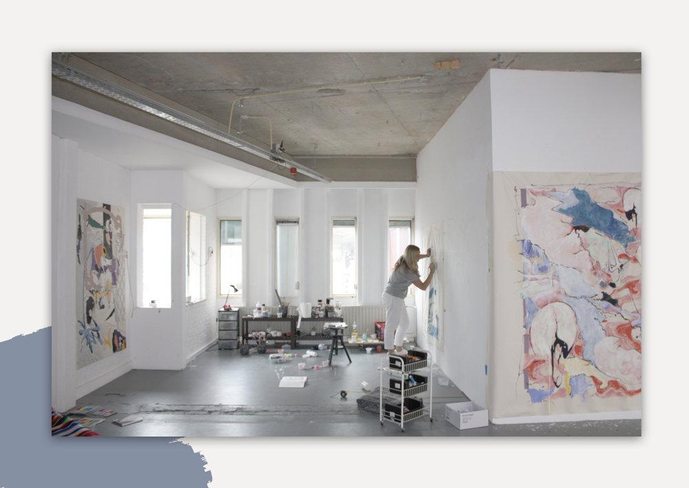 Meg Forsyth painting in her studio in the Netherlands