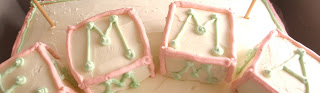Baby blocks I made from crisped rice cereal treats and butter cream frosting.