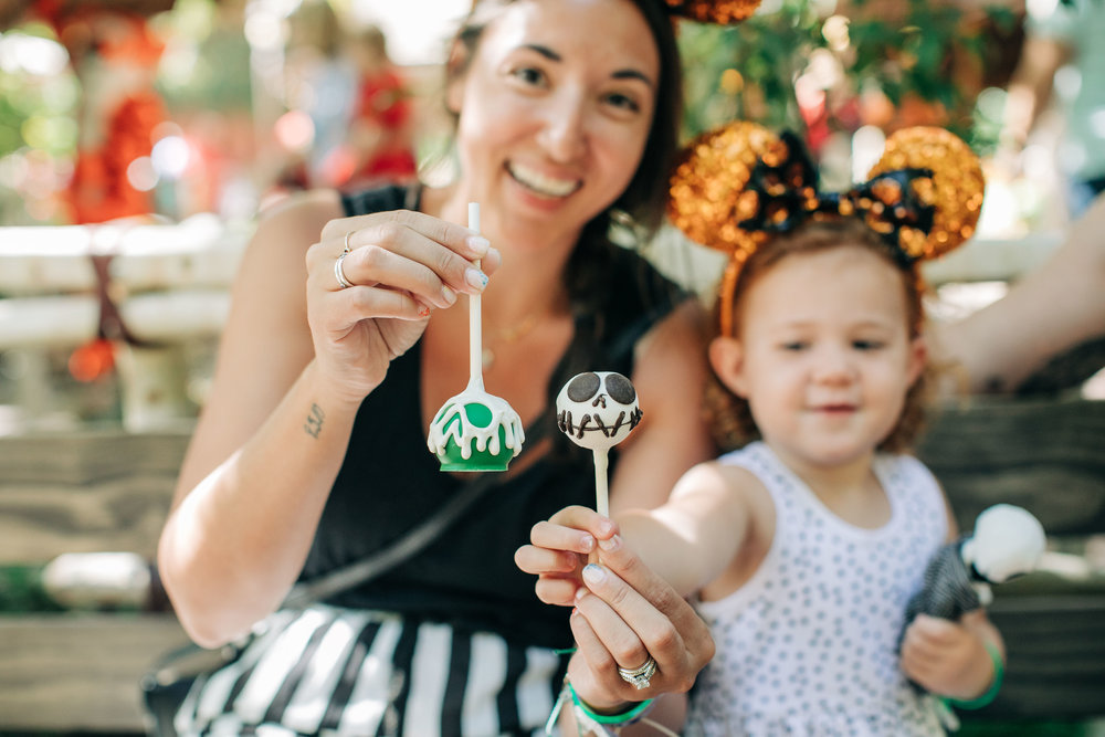 There are festive treats in every corner of both parks! We love the Halloween Time cake pops (and the churros) the best! How cute are these? Almost too cute to eat! The green poison apple one is chocolate cake and Jack Skellington is vanilla cake. You can also see the cast members making the yummy treats in person! We also love taking a few minutes to watch them decorate.