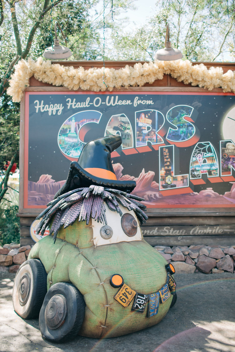 Our favorite place to visit during Halloween Time is Cars Land at Disney California Adventure Park! I love that every festive detail is done using car items. The best is the PumpCAN patch made with gas canisters painted to look like pumpkins. You can see them below…