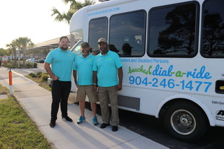 Beaches Dial-a-Ride drivers pose in front of newest para-transit vehicle in Dial-a-Ride's fleet.