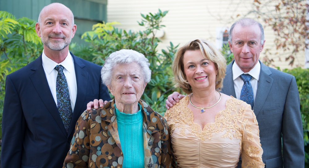 Carolyn pictured with her two brothers and her mother.