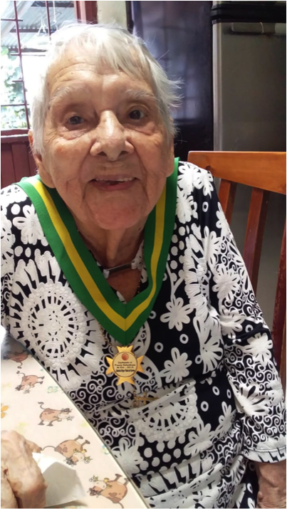 Doña Gabriela, 103, with her Golden Colombian award.
