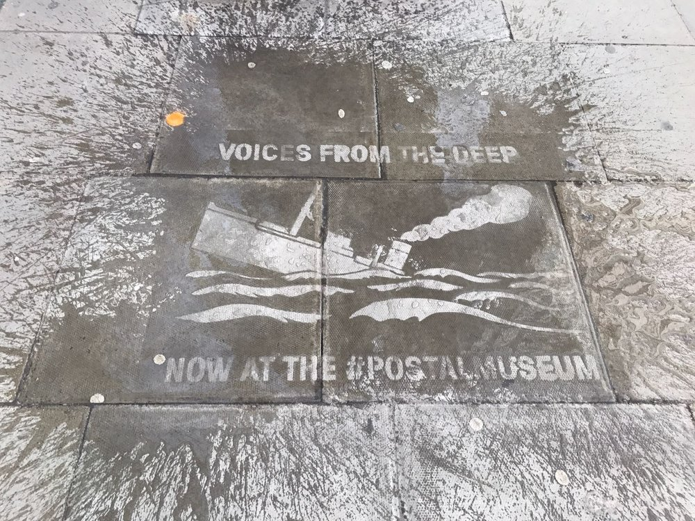 water activated pavement stencil advert for the postal museum
