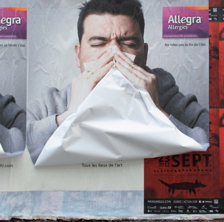 """""""To promote Allegra, ad agency Ig2 blanketed the city of Montréal with an eye-catching wild posting campaign. The 3-D ads depict a man who is blowing his nose using a part of the poster. Each poster was individually crumpled and stuck onto the man's face. The ads were strategically placed in parts of the city where people with allergies can't really take full advantage of summer. Allegra playfully reminds them that it's possible to get rid of allergy symptoms and enjoy the great weather."""