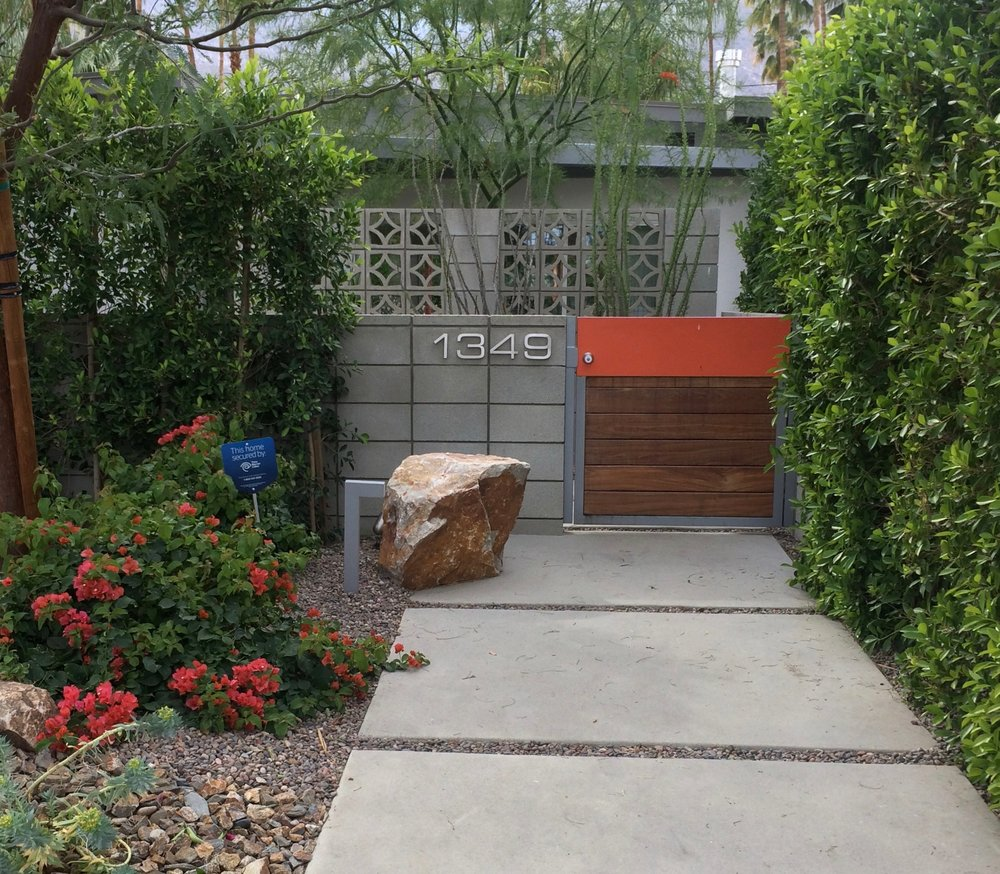 Another lovely Palm Springs home incorporating pavers, a boulder, greenery and a pop of color.