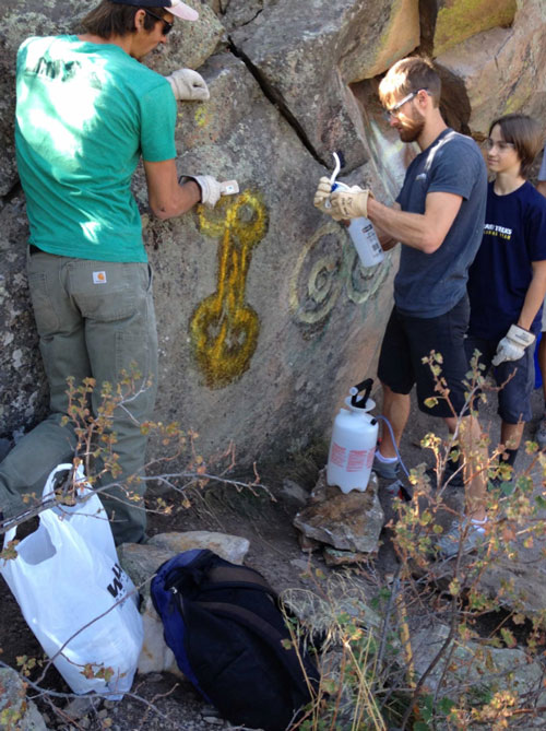 We've helped organize a few graffiti clean-up days at the popular Darkside Boulders.