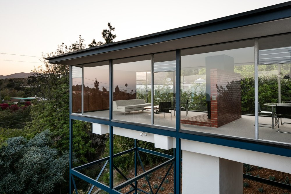 """At night, the Smith House appears to float like a glass box in space."""
