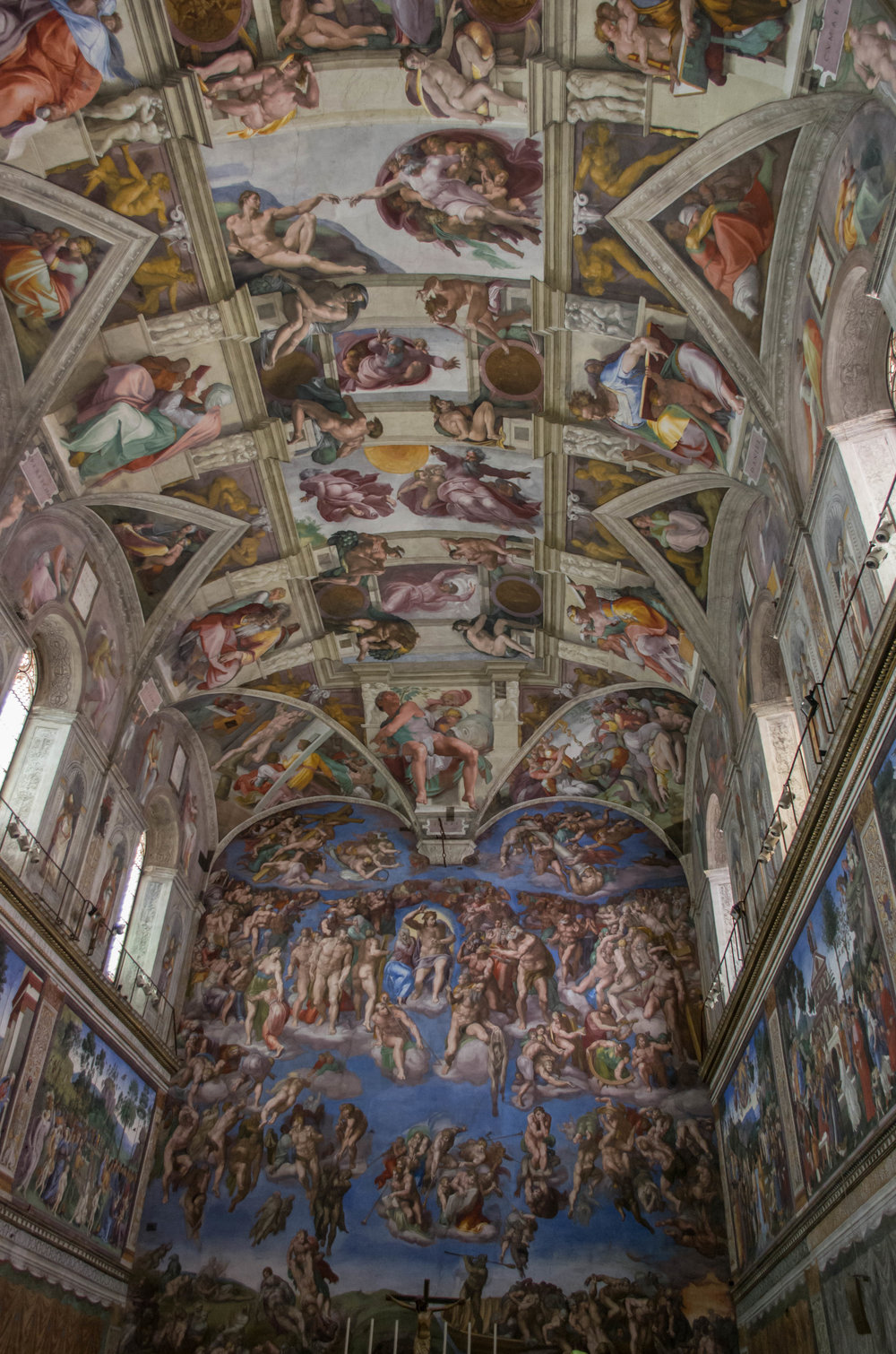 Michelangelo's frescoes on the ceiling and end wall of the Sistine Chapel