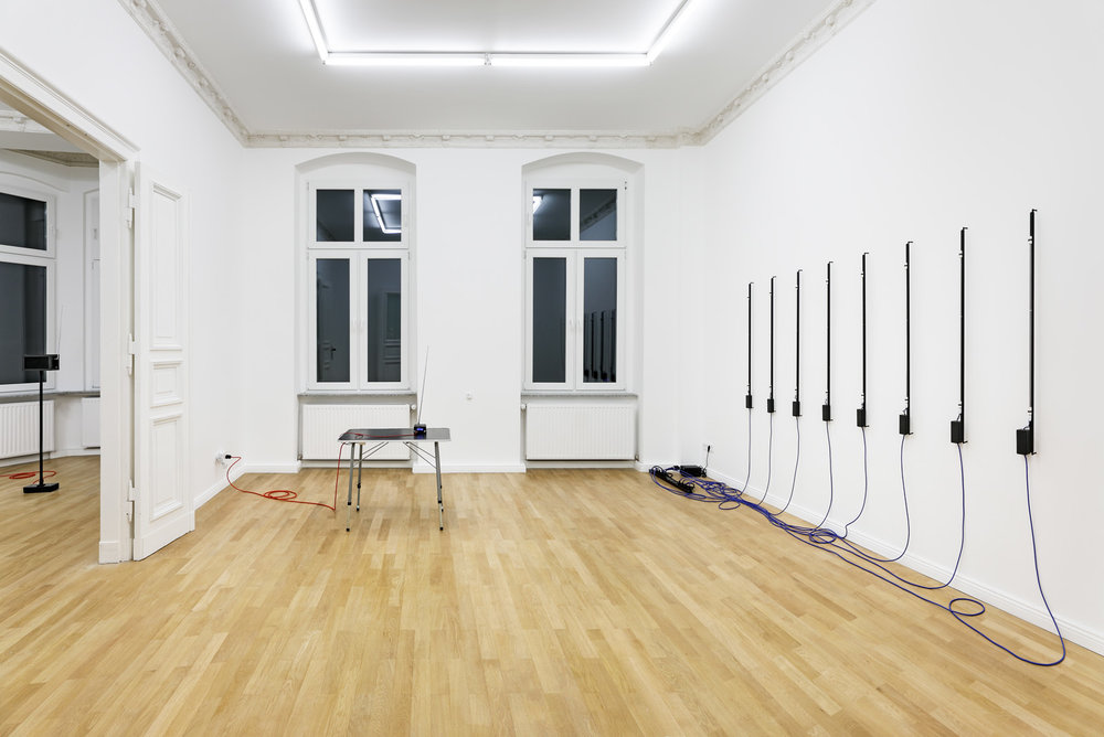 Installation view, Christopher Aque,  Red-blooded, White-skinned, and the Blues  Left to Right:  Transmission , 2018;  Transmission , 2018 (FM transmitter);  Erasure (en masse) , 2018