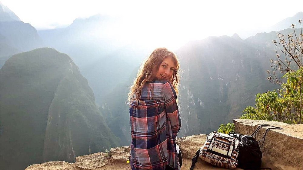 """""""I love to travel! This picture was taken at Machu Picchu after hiking up the mountain for an hour and a half at 4:30am, prior to hiking another two hours up Machu Picchu mountain (and ALL the way back down!). Not to mention my wrist was broken just before the trip,"""" says Devin."""
