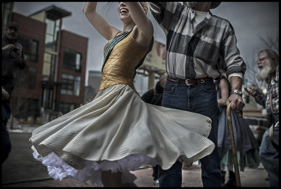Wonderbound Company Artist Julie King dancing with homeless residents outside St. Francis Center. Photo by Lena Prieto, 2014