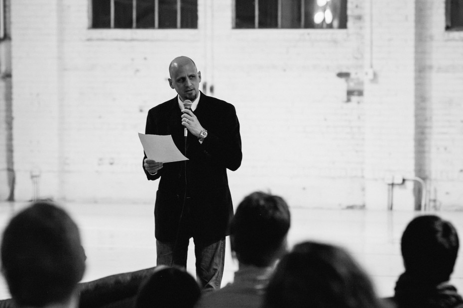 "Poet Michael J. Henry reciting the title poem from ""When the Power Goes Out."" Photo by  Amanda Tipton, 2014"