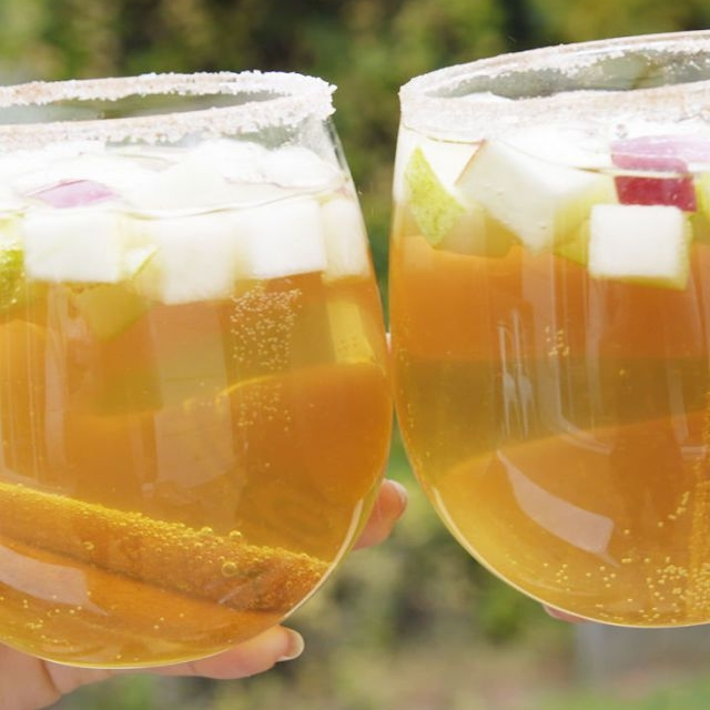 PUMPKIN PIE SANGRIA - 1 bottle white wine, chilled1 bottle sparkling cider, chilled1/2 c. pumpkin pie vodka1 pear, chopped1 apple, chopped1/4 c. sugar1/2 tsp. pumpkin spiceCinnamon sticks, for garnishSee it here