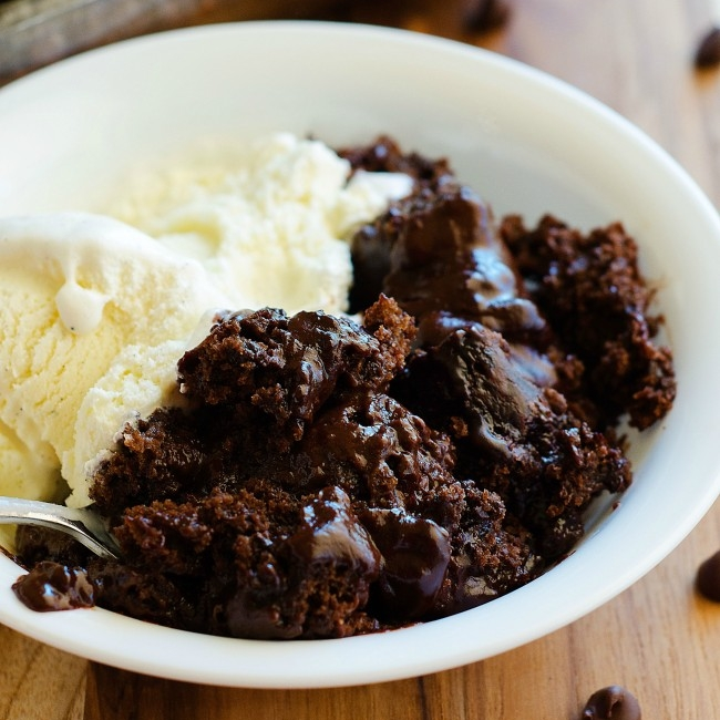 HOT FUDGE PUDDING CAKE - 1 cup sugar½ cup cocoa powder1 cup all-purpose flour2 teaspoons baking powder¼ teaspoon salt½ cup milk4 tablespoons butter, melted1 large egg yolk2 teaspoons vanilla extract½ cup semisweet chocolate chips1 cup boiling waterSee it here