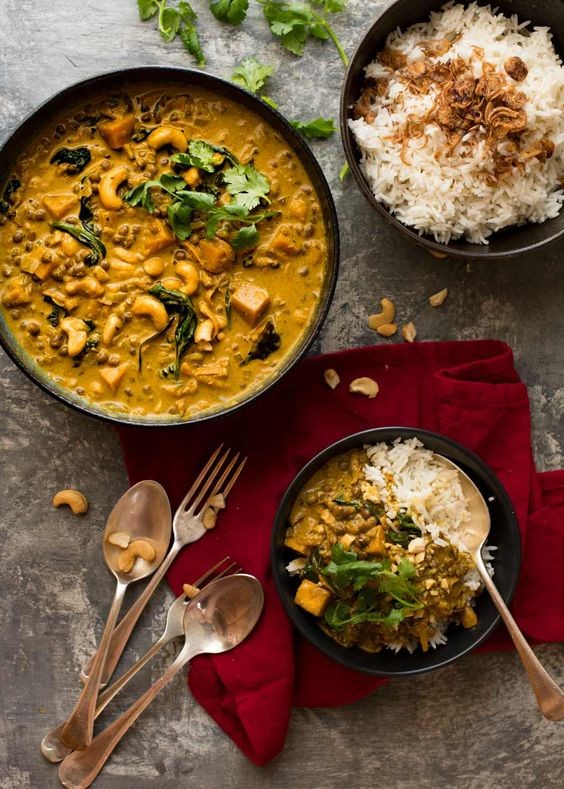 2. EASY COCONUT CURRY WITH LENTILS, PUMPKIN AND CASHEWS - IngredientsGluten free3 cups 250 g / 8 oz pumpkin80 g Baby spinach, packed400 g Brown lentils1 tsp Coriander, powder1 Coriander/cilantro, whole or chopped leaves4 Garlic cloves2 tsp Ginger, fresh1/2 Onion, brown or yellow1/2 cup Tomato passataSee it here