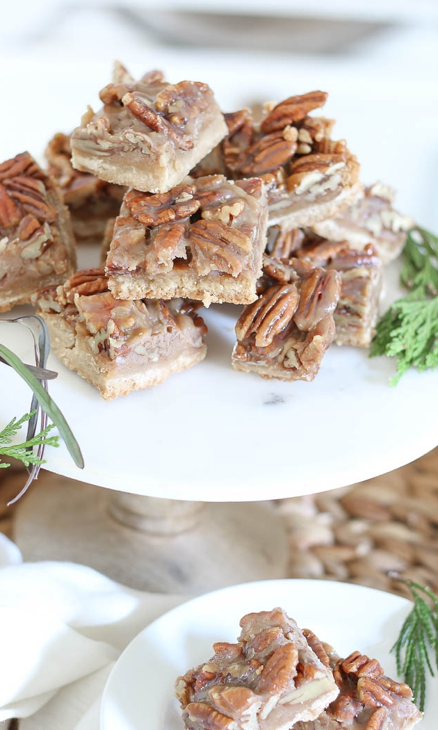 PECAN PIE BARS - Ingredients1¾ cup (3¼ sticks) unsalted butter, room temperature1¾ cup light-brown sugar, firmly packed1 tsp salt3 cups all-purpose flour¾ cup honey¼ cup granulated sugar¼ cup heavy cream4 cups (8 ounces) pecan halves1 teaspoon pure vanilla extractSee it here!