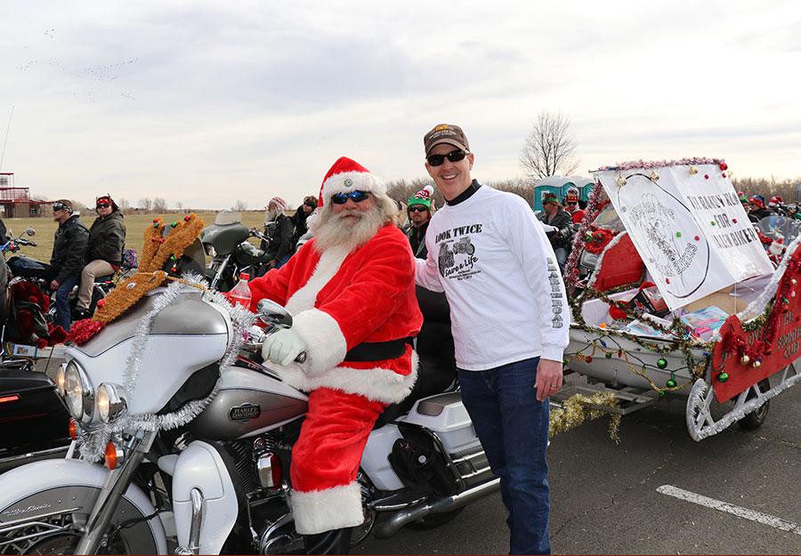 Santa (Randy Savely) and Scott O'Sullivan at the 2017 Toy Run.