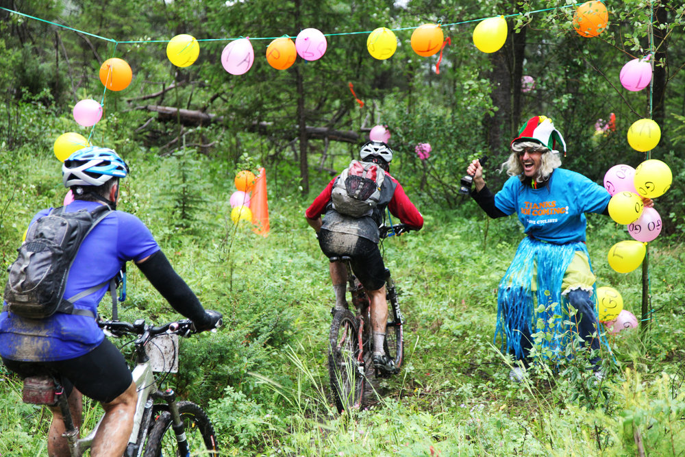 Crazy Larry cheers on the mountain bike riders at the Transrockies