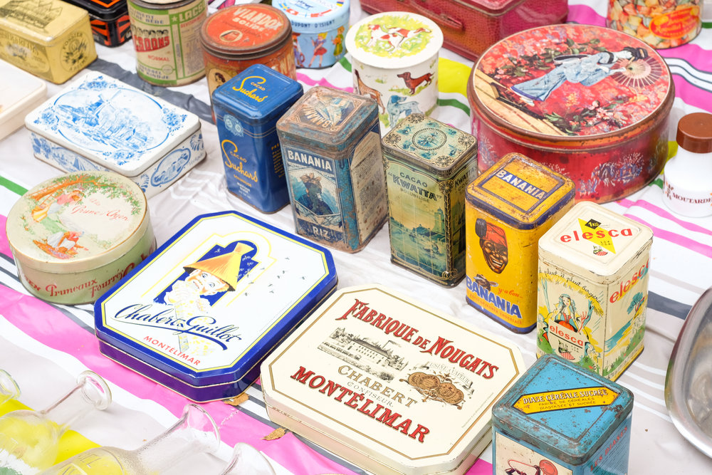 Brightly colored tins in many shapes and sizes