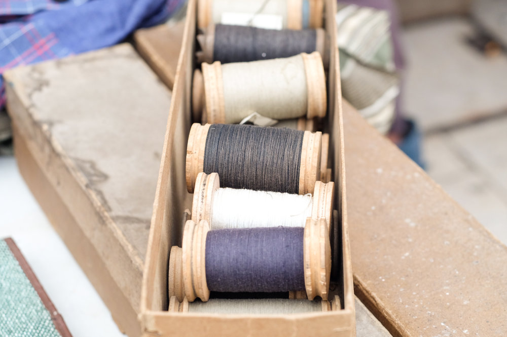 Spools of thread in muted tones