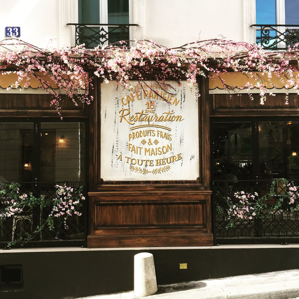 Scenes from our walk - the cherry blossoms on this café caught my eye!