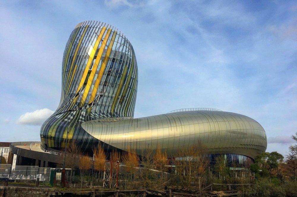 The  Cité du Vin  in Bordeaux - the shapes inside and outside the building are meant to evoke the soul of wine and the action of wine being swirled in a glass.