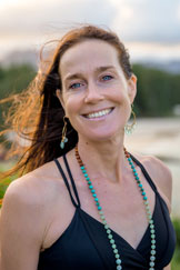 Brigitte Snyder - Brigitte's love of yoga began in 1990 after the blissful experience of her first savasana in a class taught by Brian Kent. Living in Los Angeles at the time, she was introduced to meditation in 1992 through the writings of Paramahansa Yoganada, and studied yoga with one of his devotees daily for over two years. She has done extensive training since then including studying with master teachers Mancuso Manos, Shiva Rea, Eric Shiffmann, Mary Dunn, Ramanan Patel, Rodney Yee and B.K.S. Iyengar. She has also completed two Anusara Immersion programs and is the co-owner of Aloha Yoga Kula in Kailua, Hawaii. Brigitte's classes are a joyful journey. She mixes the fluidness and creativity of vinyasa with the precision and alignment of Iyengar. As a student you will feel her attention to you as an individual, offering manual adjustments that deepen the understanding of the poses and nurturing guidance that takes you into the infinite energies of the breath and body. Since 2002, Brigitte has shared her in-depth understanding and strong technique based awareness in workshops and teacher's training programs. She is the director of Aloha Yoga Kula's Teacher's Training/Advanced Studies Program.