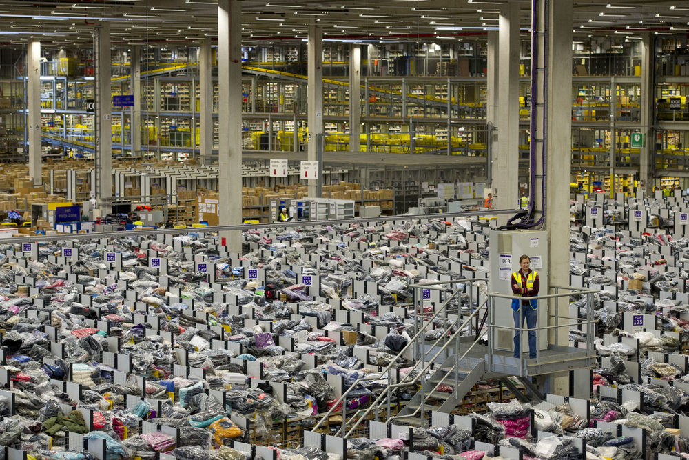 With over 100 fulfillment centers globally shipping as many as 1 million products each day, Amazon employs close to half a million workers. (Photo credit: Caters News Agency)