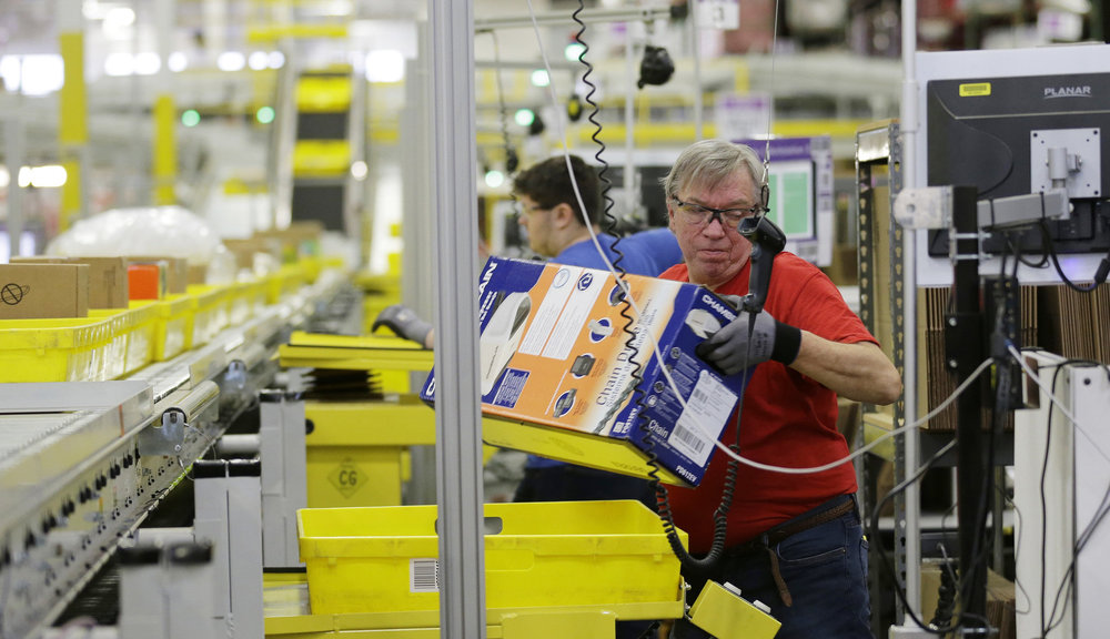 The median full-time employee in Amazon's 200,000+ American workforce earns a meager $28,000 per year. (Photo credit: The Oregonian)