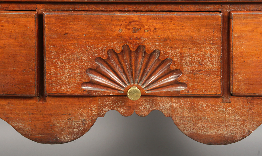 Detail of a Queen Ann highboy, as seen before conservation