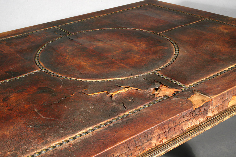 Leather desk top surface before restoration