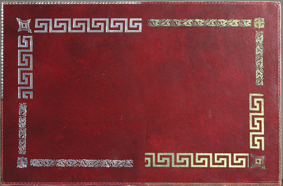 Silver, gold, and blind leather tooling sample. Please click the image to enlarge.