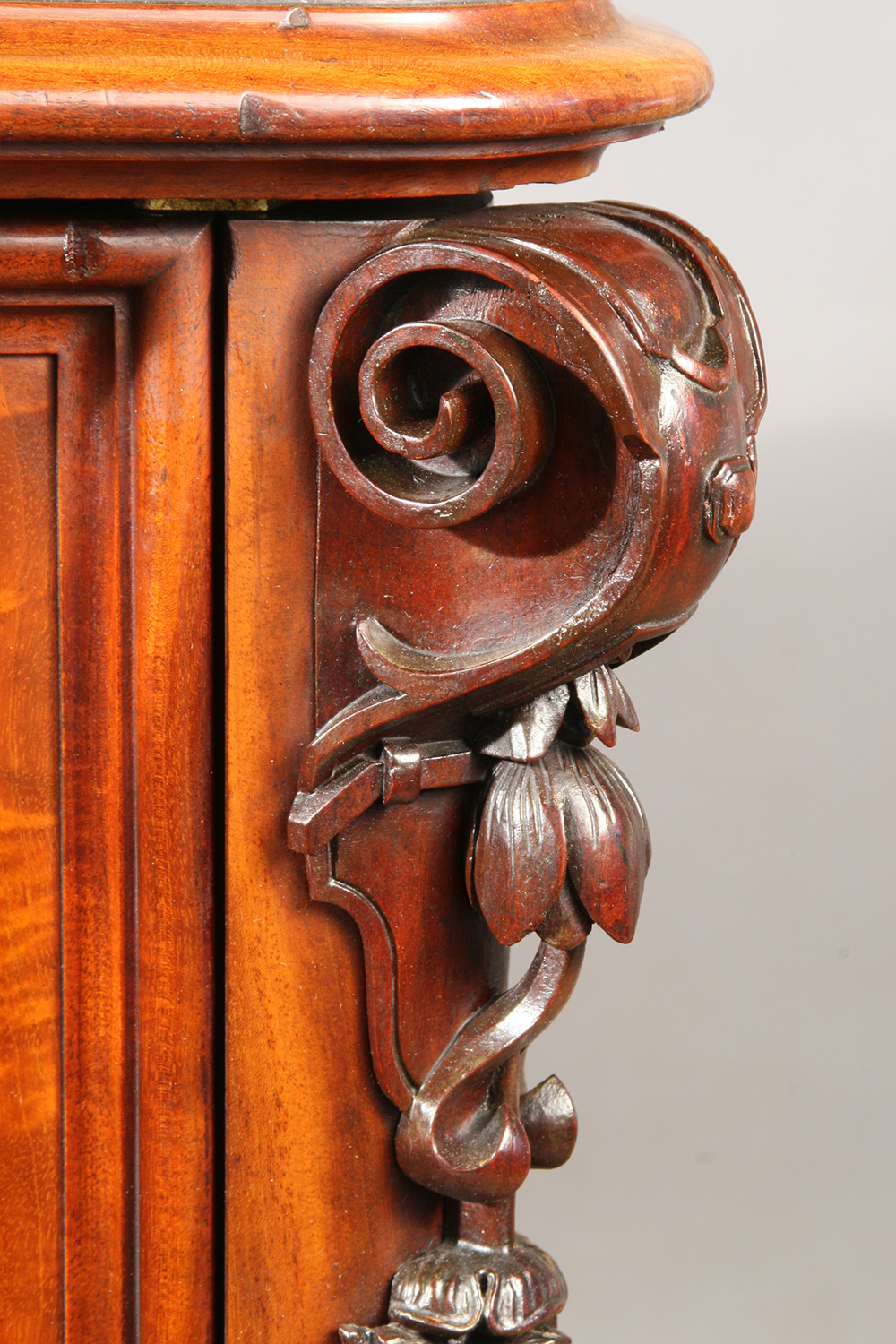 An intricately carved floral garland embellishment, seen after restoration