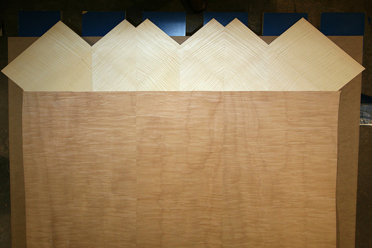 Bernacki & Associates, Inc. were responsible for the construction of two new panels that contain the doors and operating controls. Also, necessary were the alterations of the ends of two additional panels to cover the spaces created by the new doors.This involved finding new veneers to match the remaining original Maple and Sycamore veneer in color and grain patterns. The new pieces were connected to the original sections with minimum alterations while utilizing all possible old connections. (Photos below)