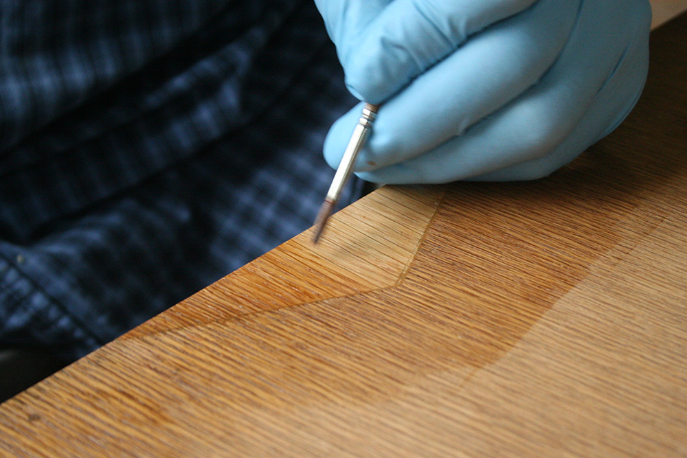 Carefully toning veneer infill by hand