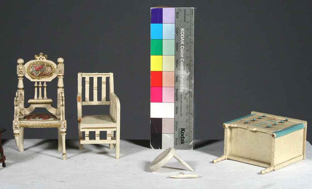 Photo:  Selected dollhouse furniture pieces before restoration