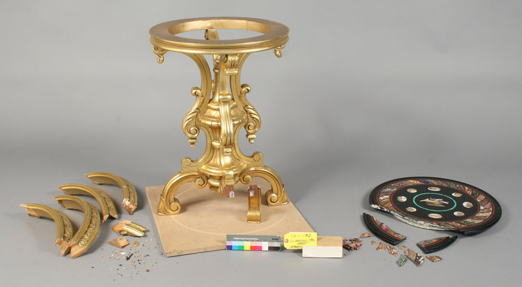Giltwood table apron detached in five sections with areas of wood loss, gesso, and gilding damage; micro mosaic marble top broken with radiating cracks throughout