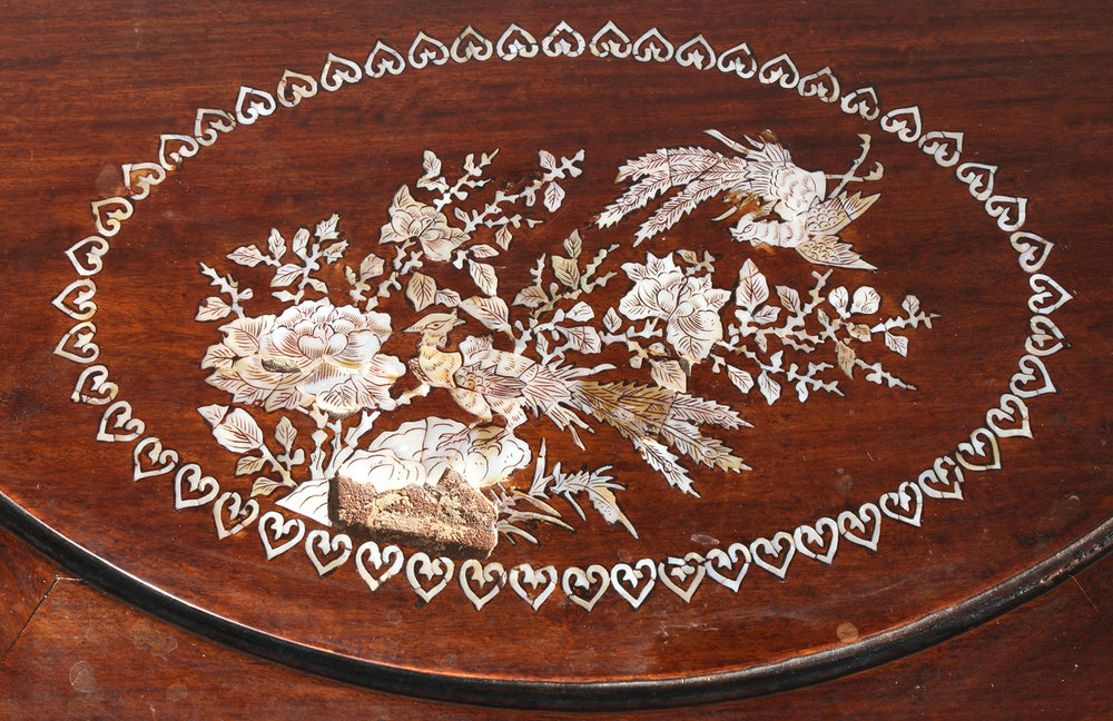 Mother-of-pearl inlay detail before conservation