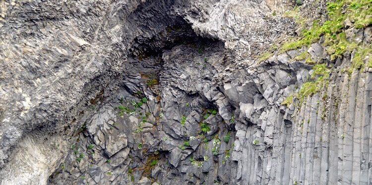 Rocks at the famous Black Sand Beach near Reykavik.