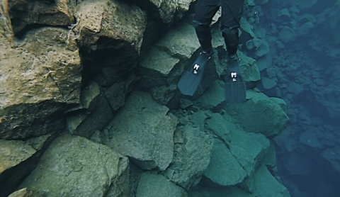 Scuba diving in the freezing water between the two tectonic plates that converge in Iceland.