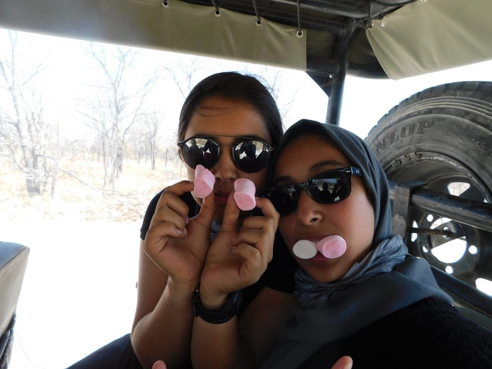 Two of my amazing best friends enjoying marshmallows on our last game drive in the reserve.